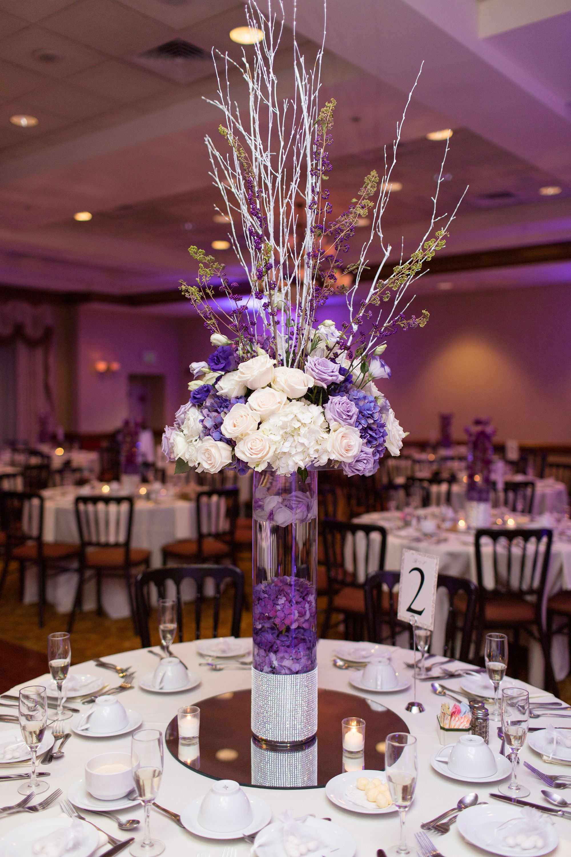 Tall Purple and Ivory Centerpieces With Sparkle | Purple wedding  centerpieces, Wedding centerpieces, Purple bridal bouquet