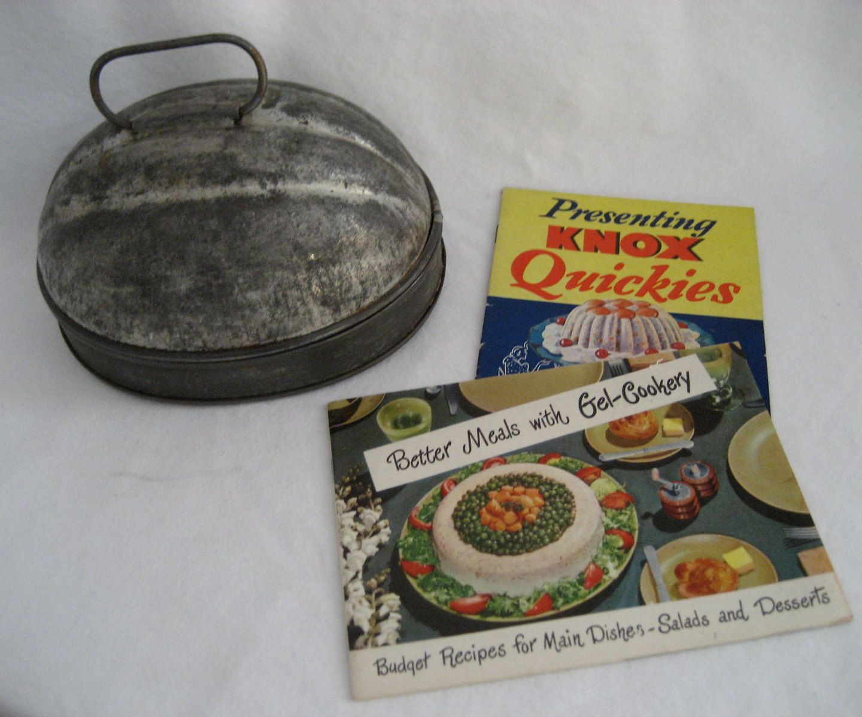 antique tin aspic or gelatin mold with cookbooks Vintage