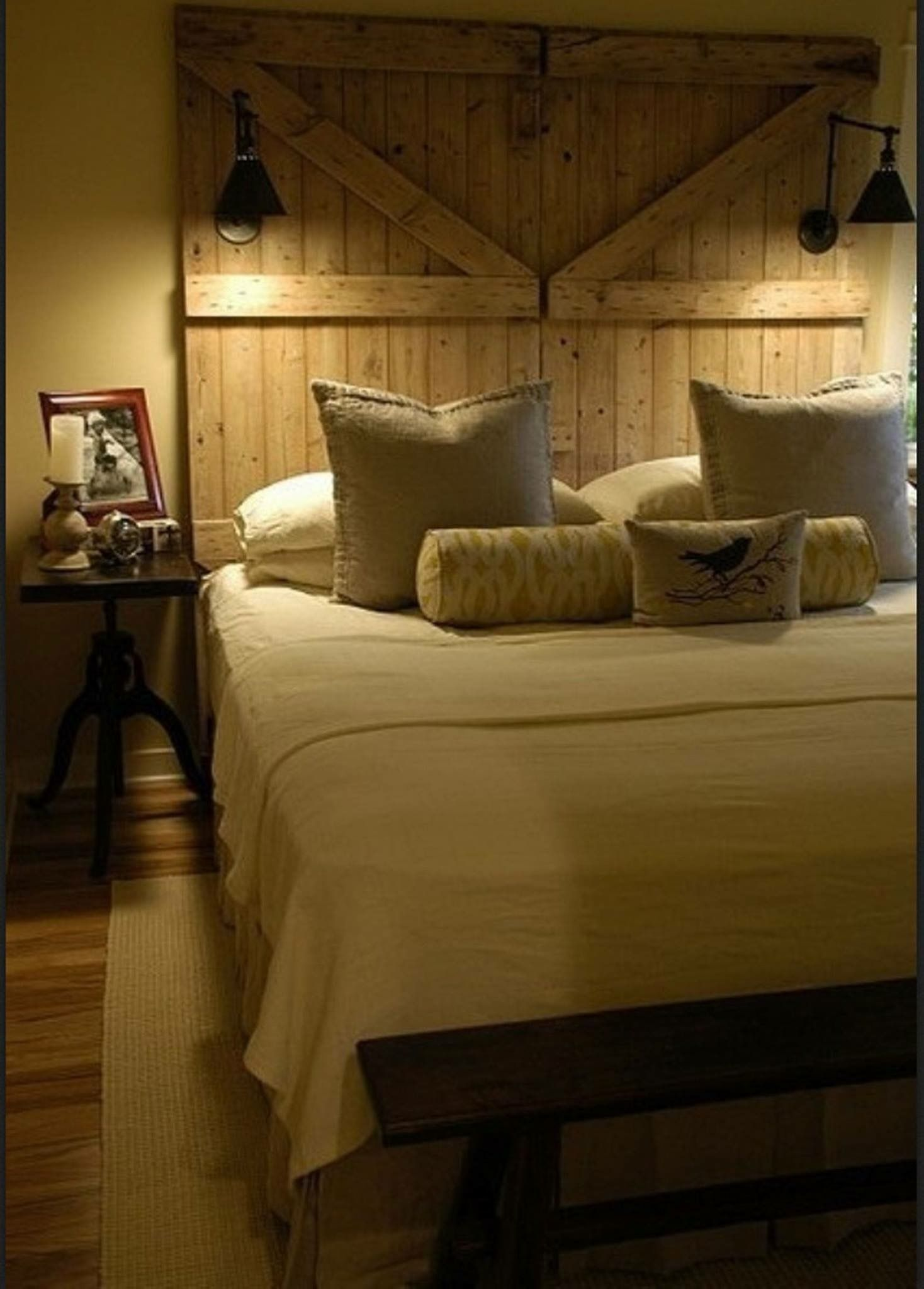 Barn door headboard with attached lights so cool bedrooms