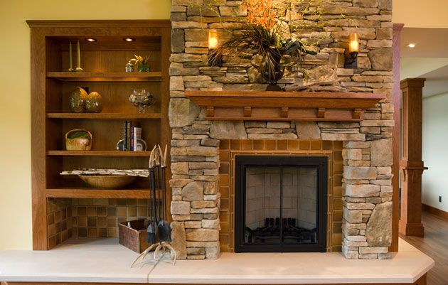 Custom Designed Fireplace With Built In Side Bookcase And