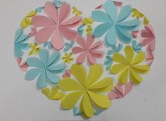 Creative wall art made of hearts. Make it and display it. It would be a cute display in a baby's nursery room.    Materials   color paper scissors glue