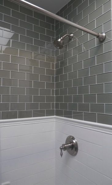 Lush custom glass subway tile river rock also this grey and white bathroom is far from boring with the use of