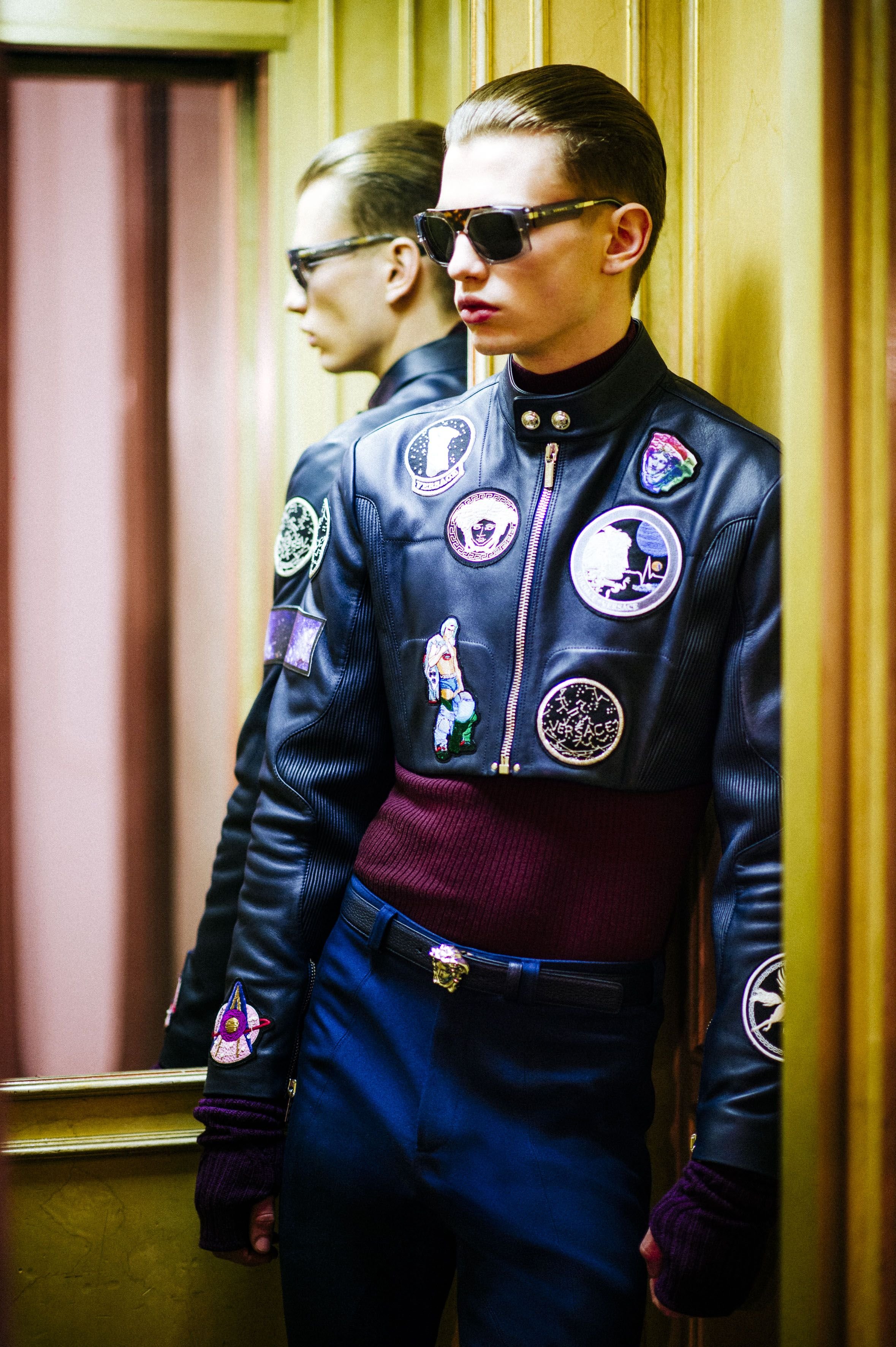 bb106c6981 Astronaut attitude - embroidered memento patches on leather jackets take  the Versace man to space. Photo by Rahi Rezvani