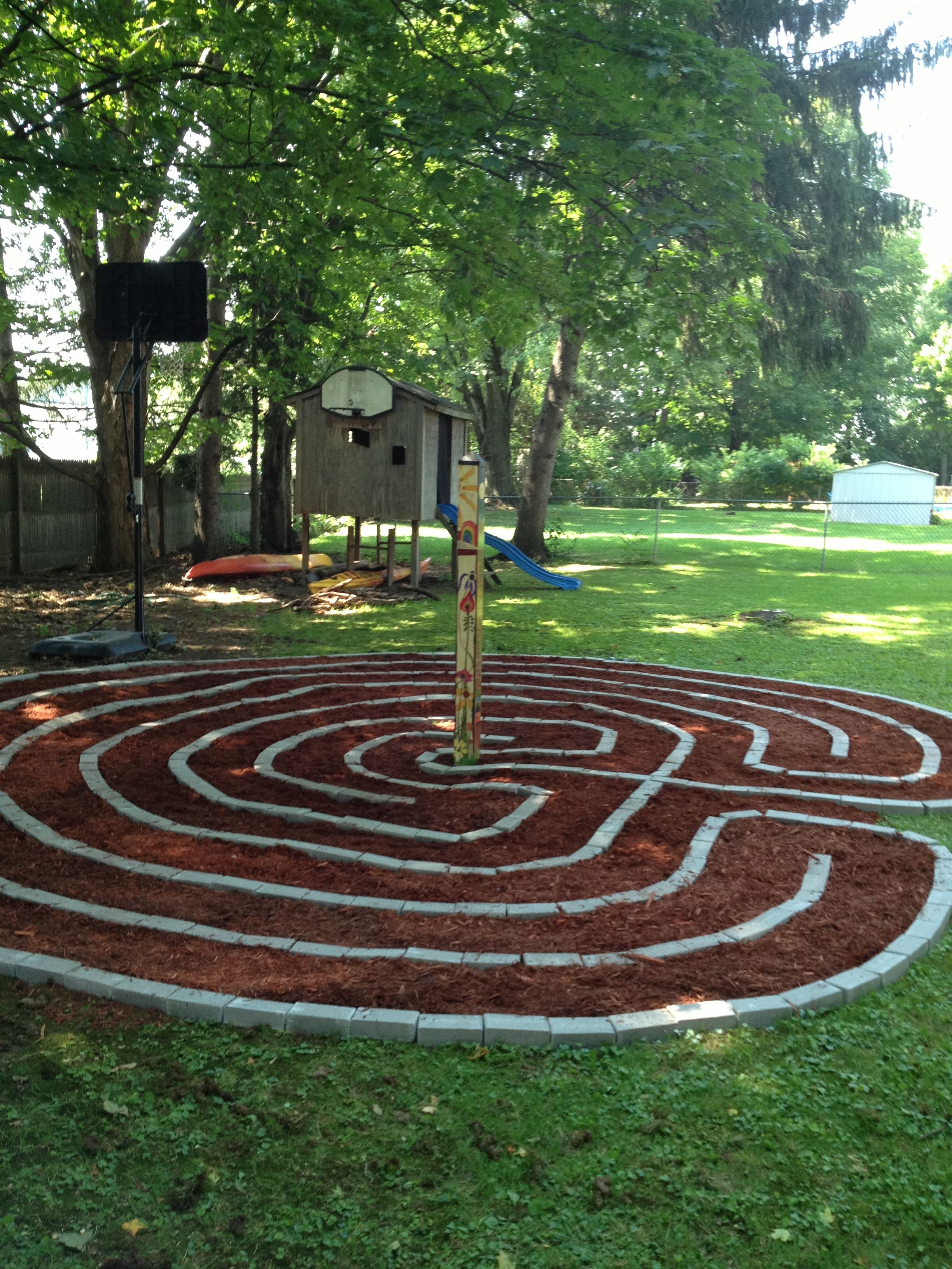 Garden labyrinth with peace pole