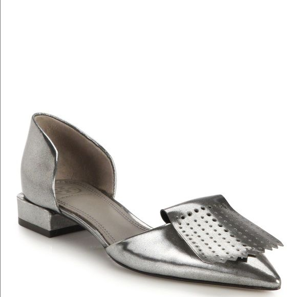 Tory Burch Hyde Metallic Perforated Flats 7.5 EXCLUSIVELY AT SAKS. The timeless d'Orsay silhouette meets modern sophistication with a perforated kiltie-inspired accent and a sleek point toe. Metallic leather upper Leather lining and sole, padded insole MSRP: $325 Worn a few times only, excellent condition. $10 off on m/ercari Tory Burch Shoes Flats & Loafers