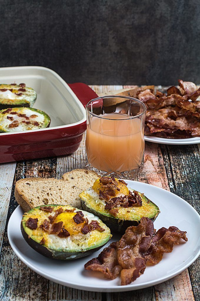 """""""Bacon Egg & Cheese Baked Avocados are the perfect start to your morning. Nutritious, protein-rich eggs baked inside of wholesome avocados, sprinkled with cheese and topped with..."""