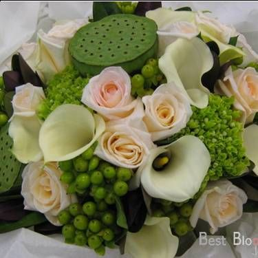 Green Lotus Pods Champagne Roses Calla Lillies And Berries Texture