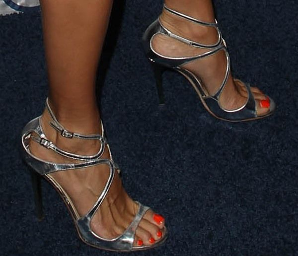 "Angie Harmon in metallic silver Jimmy Choo ""Lang"" sandals"