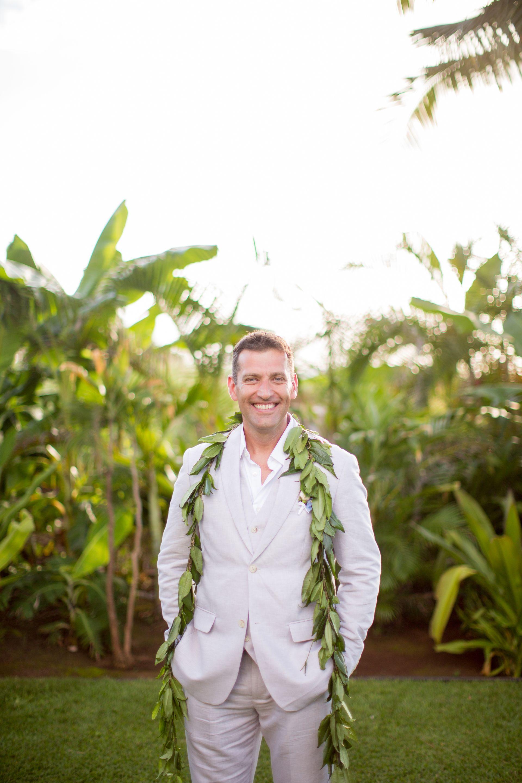 tropical groom attire, leafy garland, hawaiian wedding