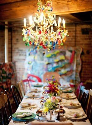 Glam and rustic thanks to a great chandelier in an unexpected space