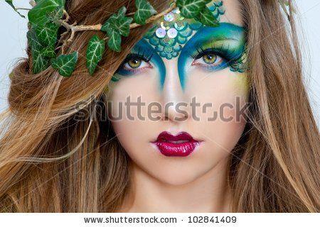 stock photo  beautiful creative fashion makeupdryad