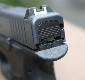 Rear sight of the G42 is dovetailed and has a white outline square notch. Notice the upper rear of the frame and the nice beavertail effect. Author photos