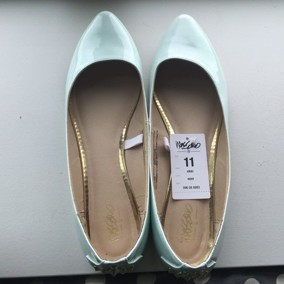 NWT light mint colored flats NWT mint colored flats form Target. Women's size 11. Pointed toe and has gold studded detail on back heel of shoes. Mossimo Supply Co Shoes Flats & Loafers