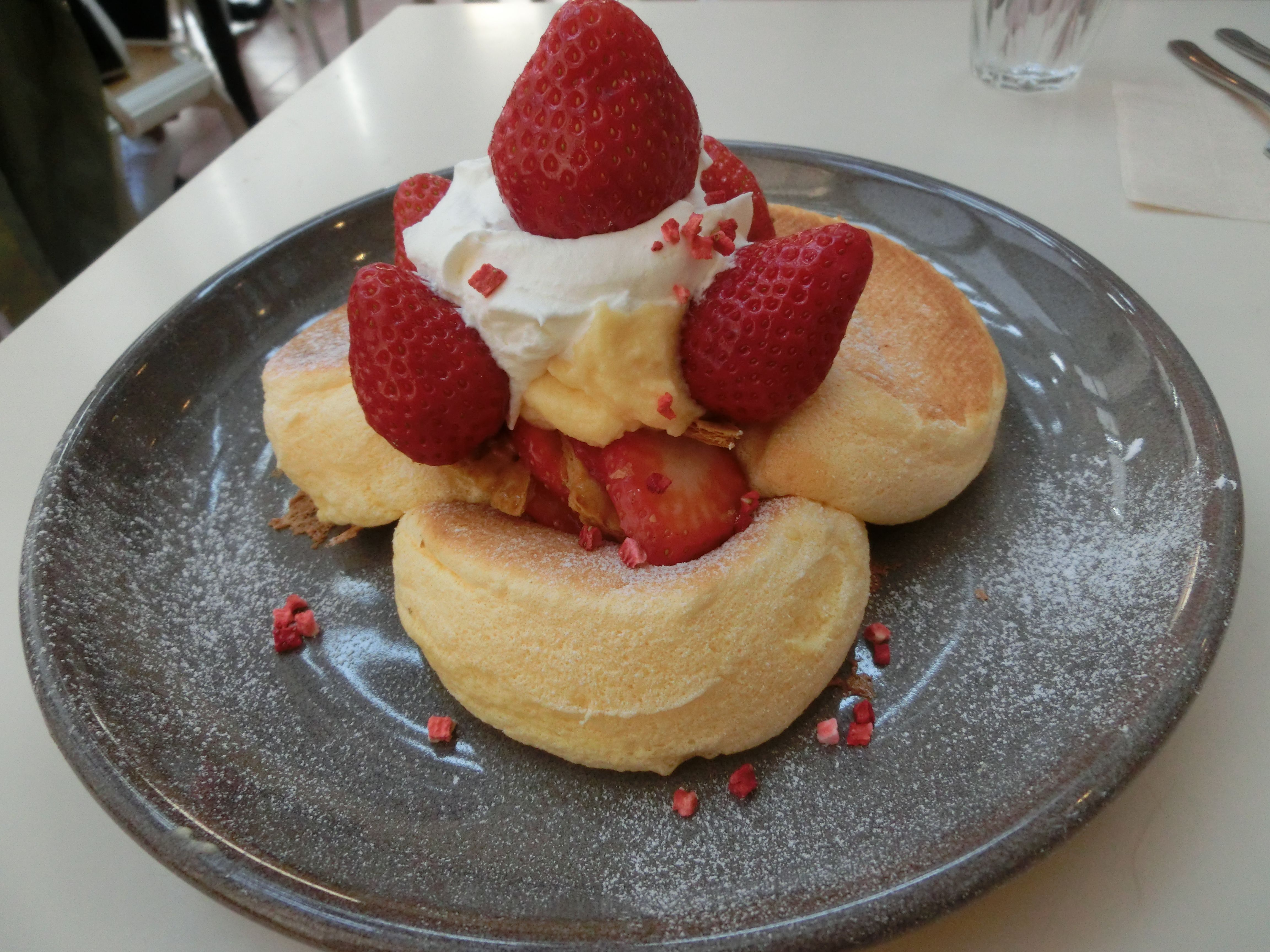 [I ate] souffle pancakes with strawberries and custard  ...
