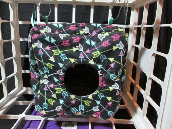 Mismatched fleece on the inside and fabric on the outside. Tab hanging. Suitable for small pets such as rats and Guinea Pigs. 8 inch cube.
