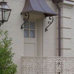 Traditional Porch By Hull Historical Roof Awnings And Overhangs General Roofing Systems Canada Grs Roof Front Door Awning Traditional Porch Metal Awning