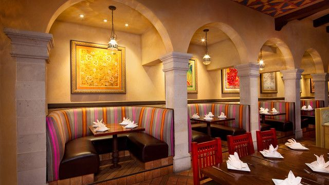 4 booths in alcoves with overhead hanging globe lights