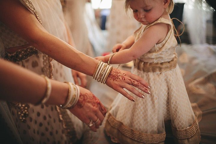 Bridesmaids and flower girl in champagne and gold dresses #bridesmaids #flowergirl #indianwedding