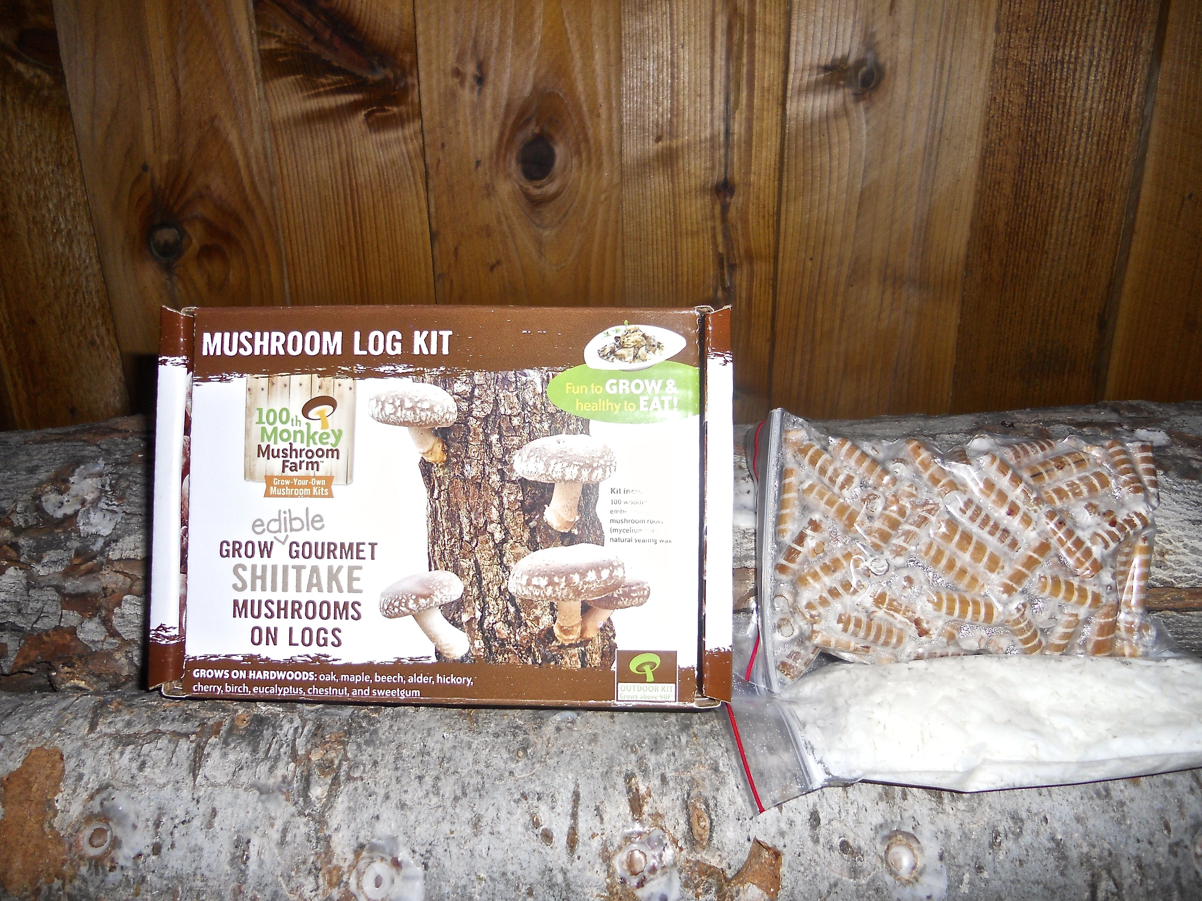100th Monkey Mushrooms Farms Shiitake mushroom log kit with everything needed to grow delicious mushrooms on a log. Kit includes pack of dowels and natural soy wax for sealing.