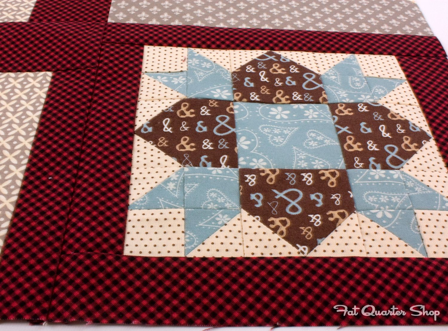 Debbie's first barn in the Quilty Barn Along is so cute!  These reds are adorable!