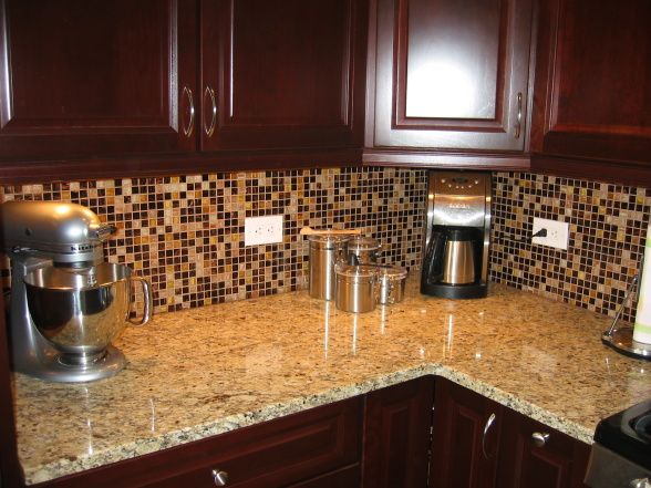 granite but our cabinets are cinnamon is the backsplash too busy