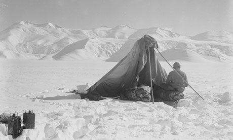 A photograph taken by Captain Scott in the Antarctic of Dr Wilson sketching at Beardmore glacier on 13 December 1911.