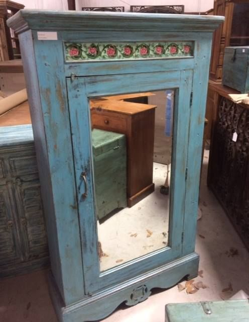 This painted cabinet has beautfiul rose tile inserts and a mirror front. Has a matching console table that would look great in both traditional and contemporary homes. Wonderful storage and so much character.
