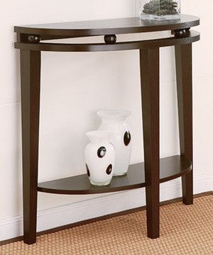 With a rich finish accentuating the tones of the solid construction, this table is sure to look elegant wherever it's placed. It features a sturdy top and shelf, making it perfect for displaying a lamp or some treasured family photos.