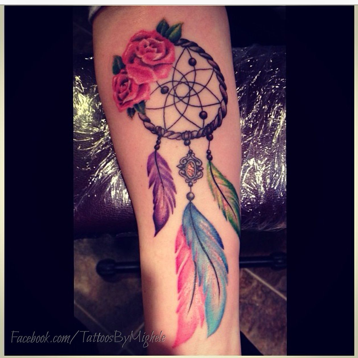colourful dream catcher tattoo. i want something like this but on