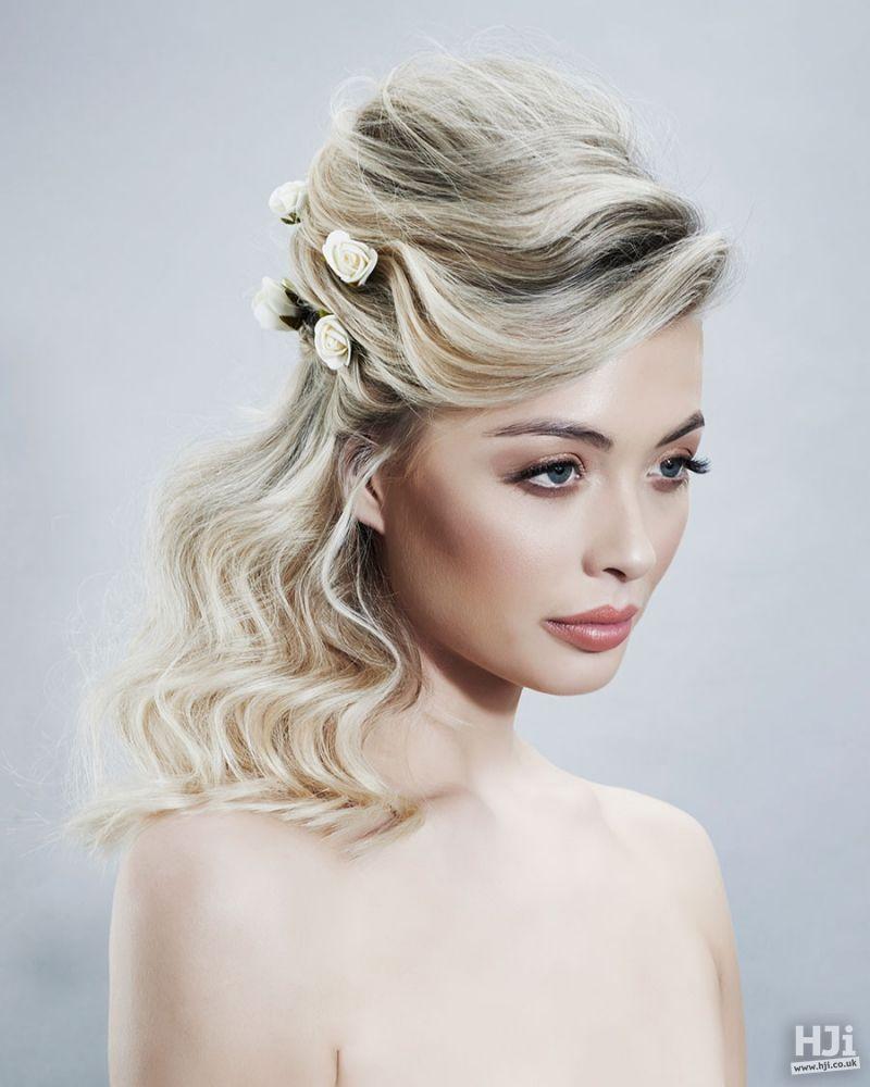 Blonde hair weaving bridal hairstyle with flowers bride