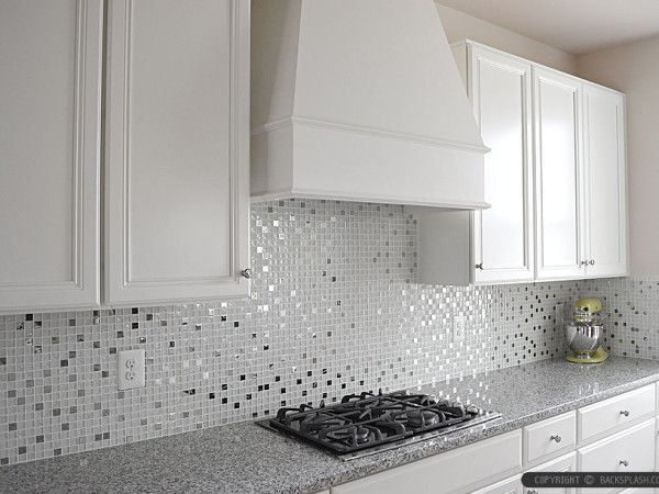 White glass and metal kitchen backsplash used for this kitchen