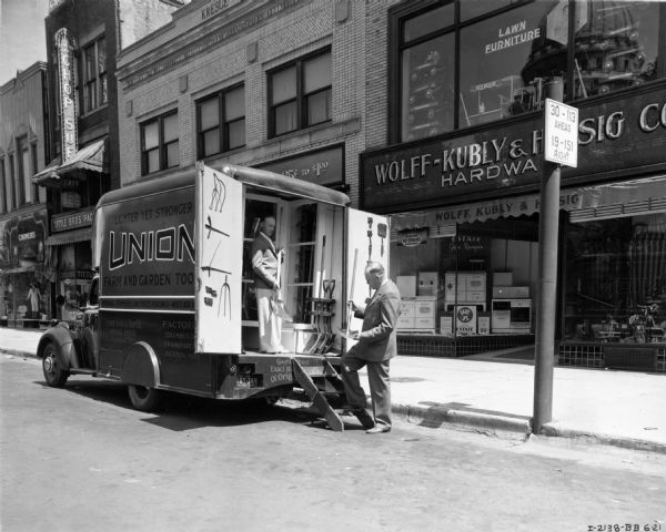 International D-15 Truck Delivering Goods to Wolff-Kubly & Hirsig Hardware Store | Photograph | Wisconsin Historical Society