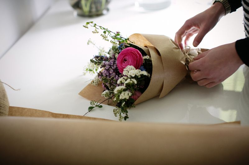 Cut spring flowers with ranunculus and lilac and spring spirea. By London Florist Botanique Workshop.