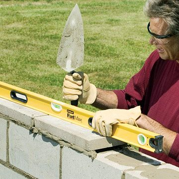 How to Build a Concrete Block Wall | Concrete block walls, Block ...