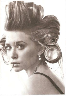 I am obsessed with the photo of Ashley Olsen , with Diet Coke cans in her hair, looking incredibly old-school glam. I also find myself imagi...