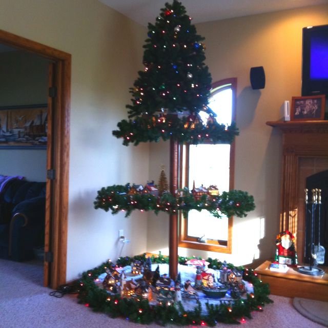 Christmas tree used to display collectable houses Craft Ideas