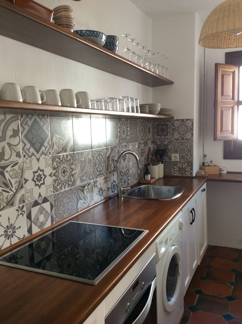 Simple Kitchen With Open Shelves In Beach Appartment Of Playa