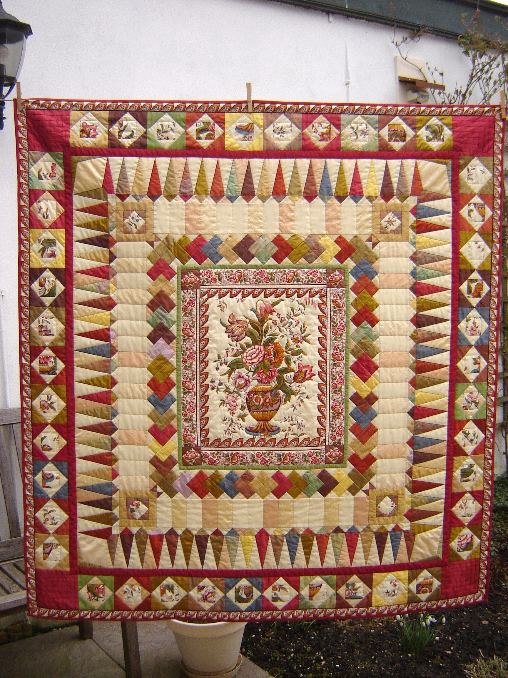 at completed quilting of love arm main monterrey services pictures client quilts medallion mainely long quilt