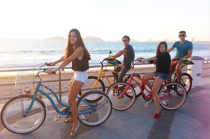 """Book your adventure - The best way to discover Mazatlan and enjoy its astonishing sights is on a bicycle. Join us for a ride that includes it all: architecture, history, culture, beach life, good times and one of the best sunsets of the Pacific Ocean. This self-guided tour is an easy ride, filled with fun for all ages and fitness levels! Start the tour at the meeting point, right in """"El Malecón,"""" a 4-mile"""