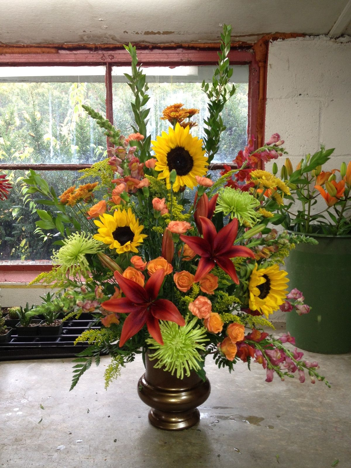 A Beautiful Funeral Arrangement Using Lilies And Sunflowers