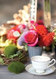 Low floral centerpiece with tea cups