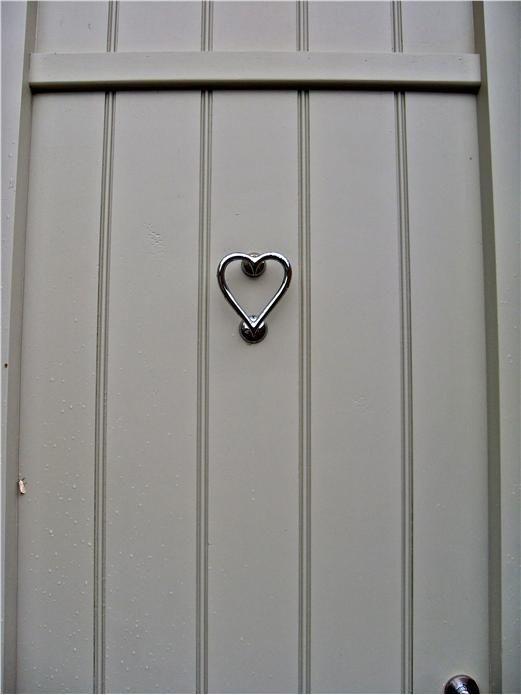 Dusky grey front door with heart shaped nickel door for Front door paint colours