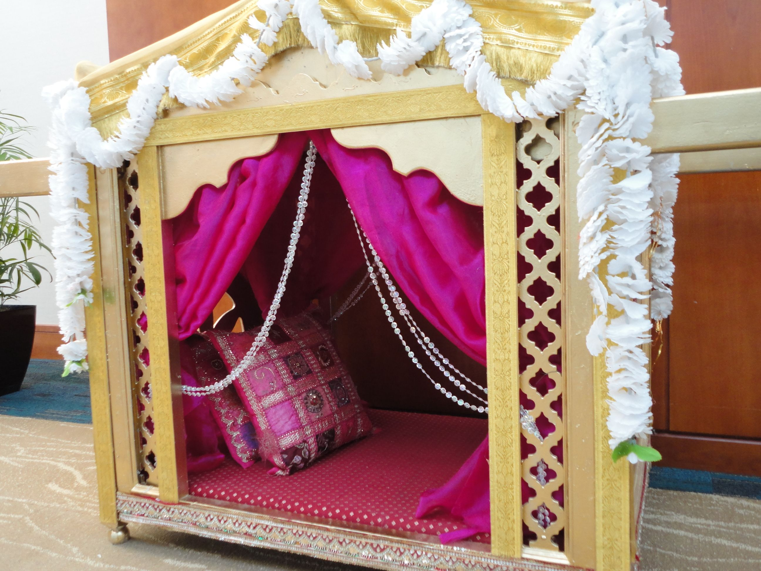 The bride was carried into the ceremony on a doli palanquin the bride was carried into the ceremony on a doli palanquin junglespirit Gallery