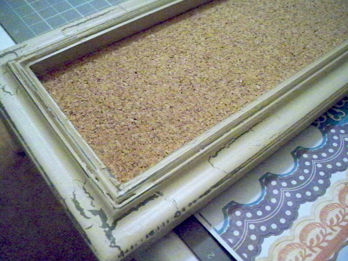 making a cork board from an old frame to put family calendar on saw
