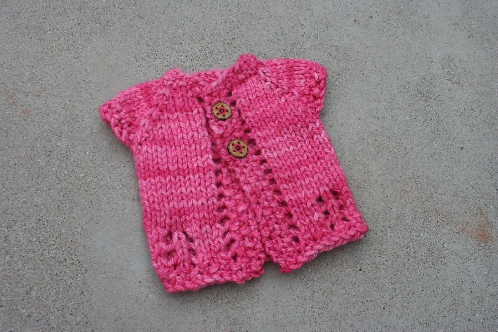 Wee Sweet is a super-fast to knit baby sweater, and only takes an hour or so to make from start to finish.This is knit top down, and you will only have 2 ends to weave in.The adorable handmade button can be found in the Etsy shop: KatrinklesYarn weightBulky / 12 ply (7 wpi) ? Gauge11 stitches = 4 inchesNeedle sizeUS 10½ - 6.5 mmUS 11 - 8.0 mmYardage70 yards (64 m)Sizes available0-3 months