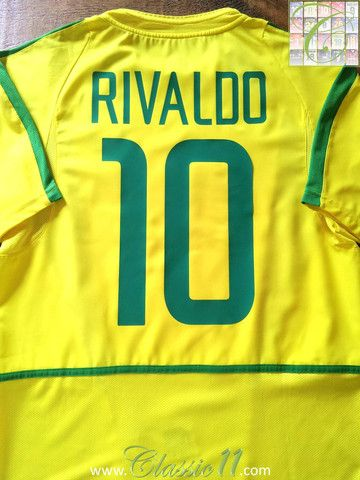 e9b0818698d Relive Rivaldo s 2002 World Cup with this vintage Nike Brazil home football  shirt.