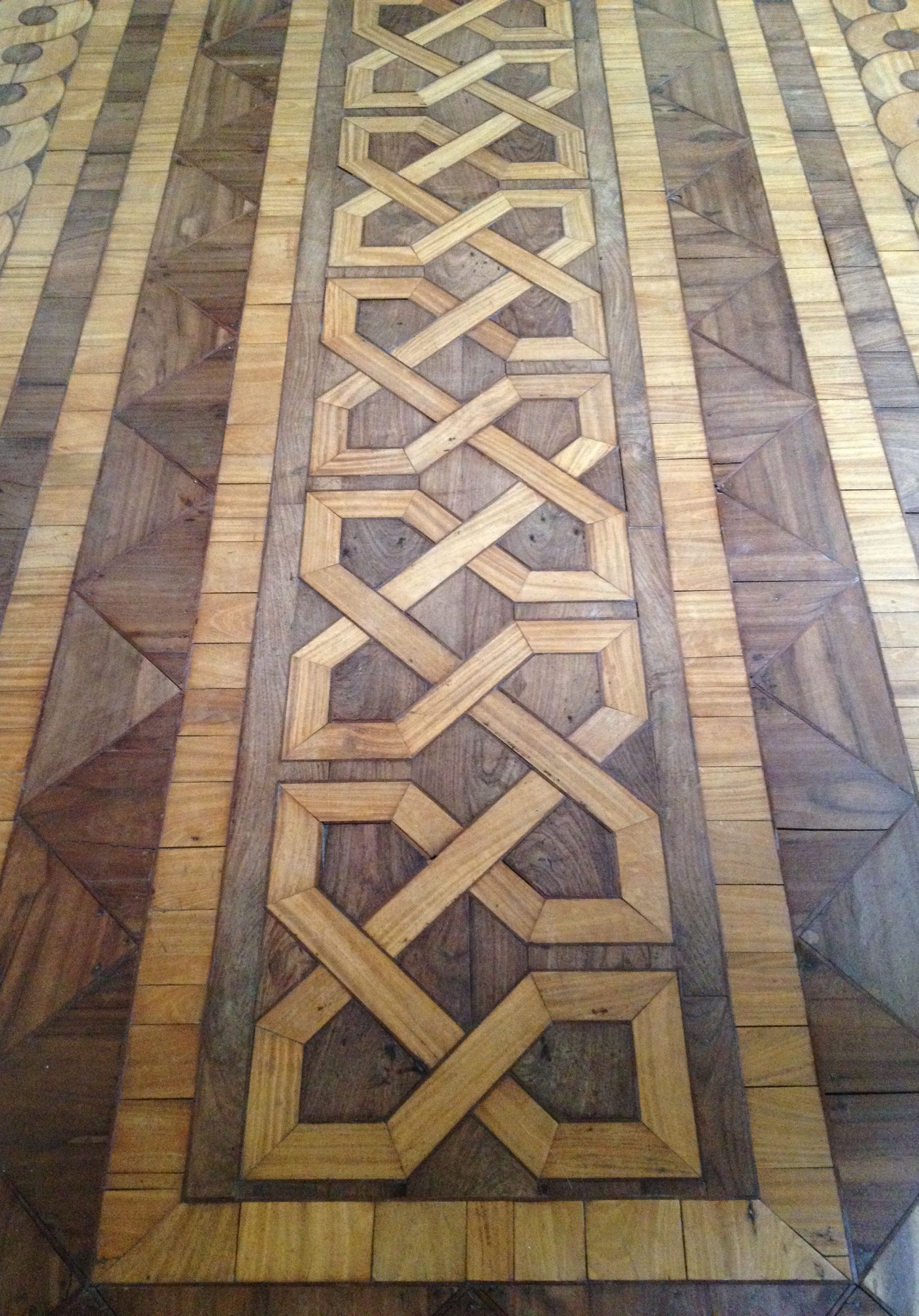 Two sections of the marquetry floors in the saloon at Ballyfin, County Laois. Dating from the 1820s and designed by the Morrisons père et fils, the house was built for Sir Charles Coote, premier ba...