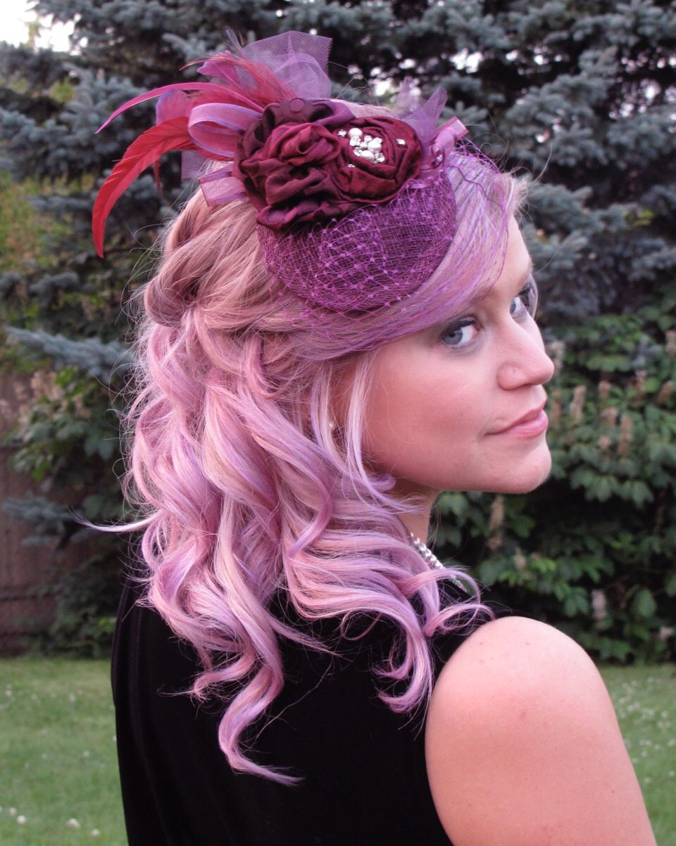 Beautiful, rich plum & cranberry fascinator. Blossoms of burnout crepe & satin, glittery bling, feather & Russian veil. So unique for a mother of the bride or groom or a adventuress bride. $120