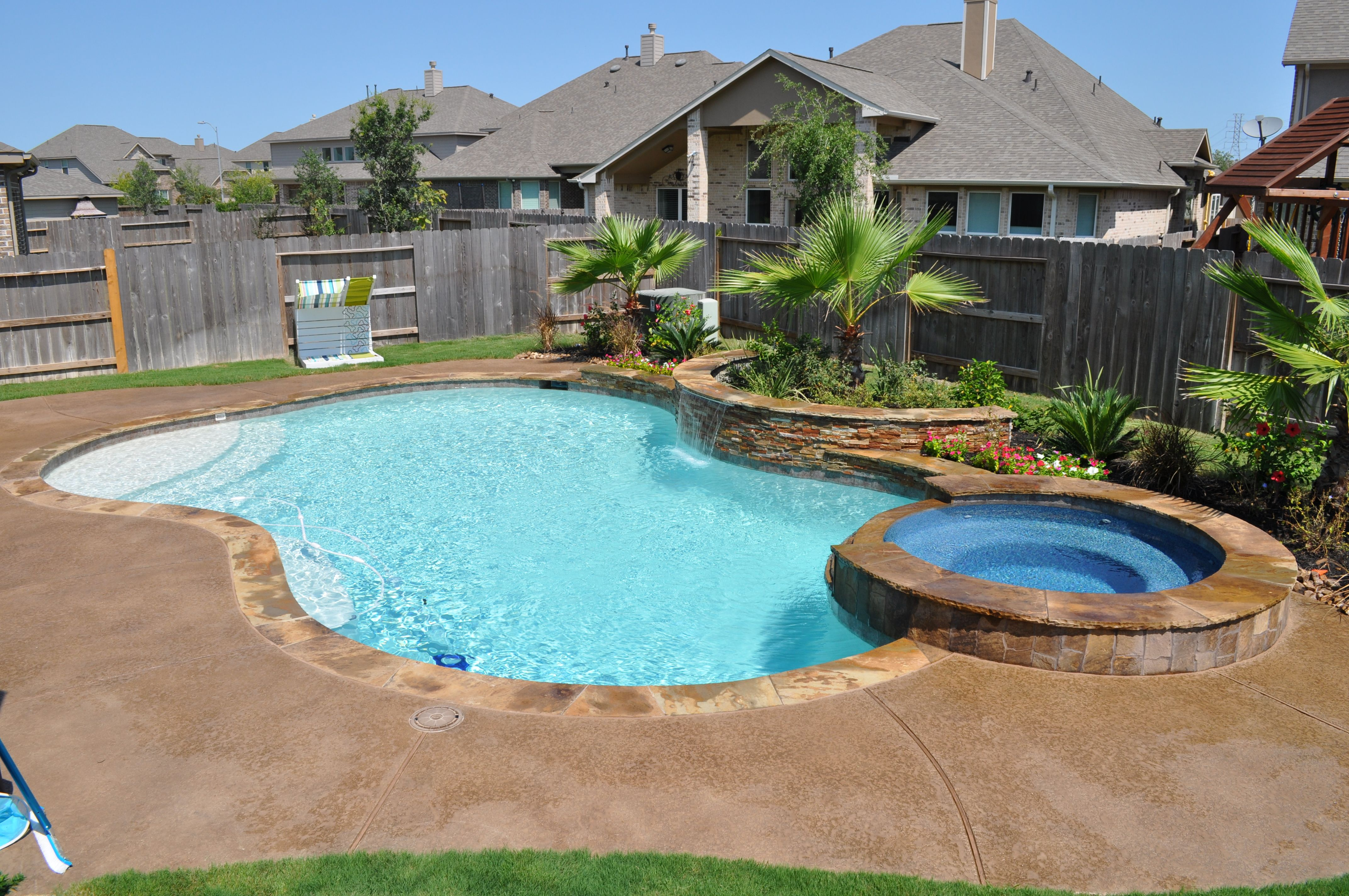 Free Form Swimming Pool And Spa In Katy Tx Houston Tx Features Raised Spa Tiered Flagstone