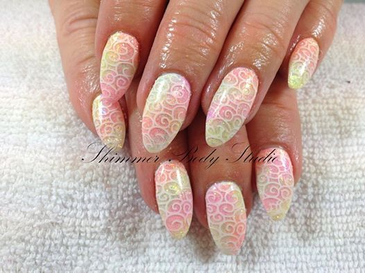 Photo: Taking a trip to candyland, with pastel glitters and stamping!  Gel nails, glitter nails, pastel nails, almond nails, stamping nail art by Shimmer Body Studio.